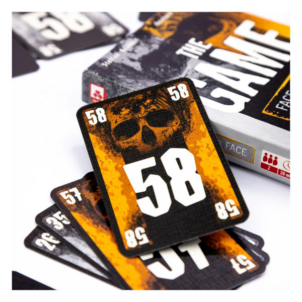 The Game Face to Face Card Game box cover and cards.
